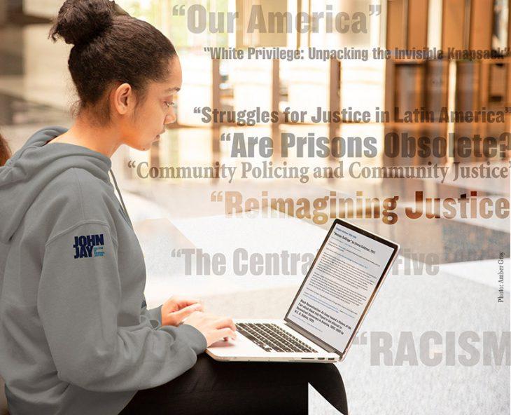John Jay student on laptop